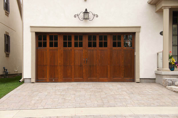 2016 garage door trends garage remodeling costs for Wood looking garage doors