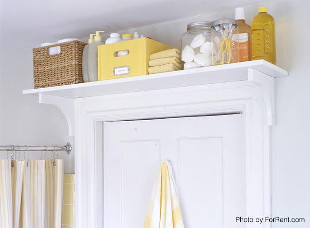 small bath storage storage above the door